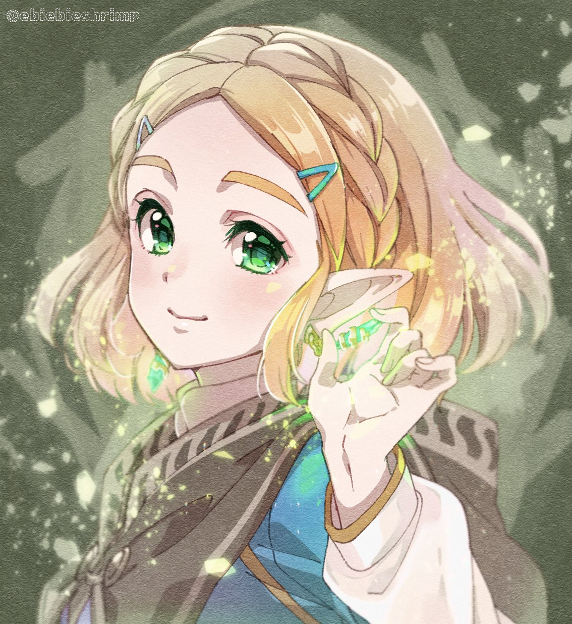 1girl blonde_hair blush braid brown_cape cape closed_mouth colored_eyelashes crown_braid emerald_(gemstone) forehead glowing green_eyes hair_ornament hairclip hand_up highres holding holding_gemstone hood hood_down hooded_cape long_sleeves looking_at_viewer pointy_ears princess_zelda short_hair shuri_(84k) sidelocks smile solo the_legend_of_zelda the_legend_of_zelda:_breath_of_the_wild the_legend_of_zelda:_breath_of_the_wild_2 thick_eyebrows upper_body