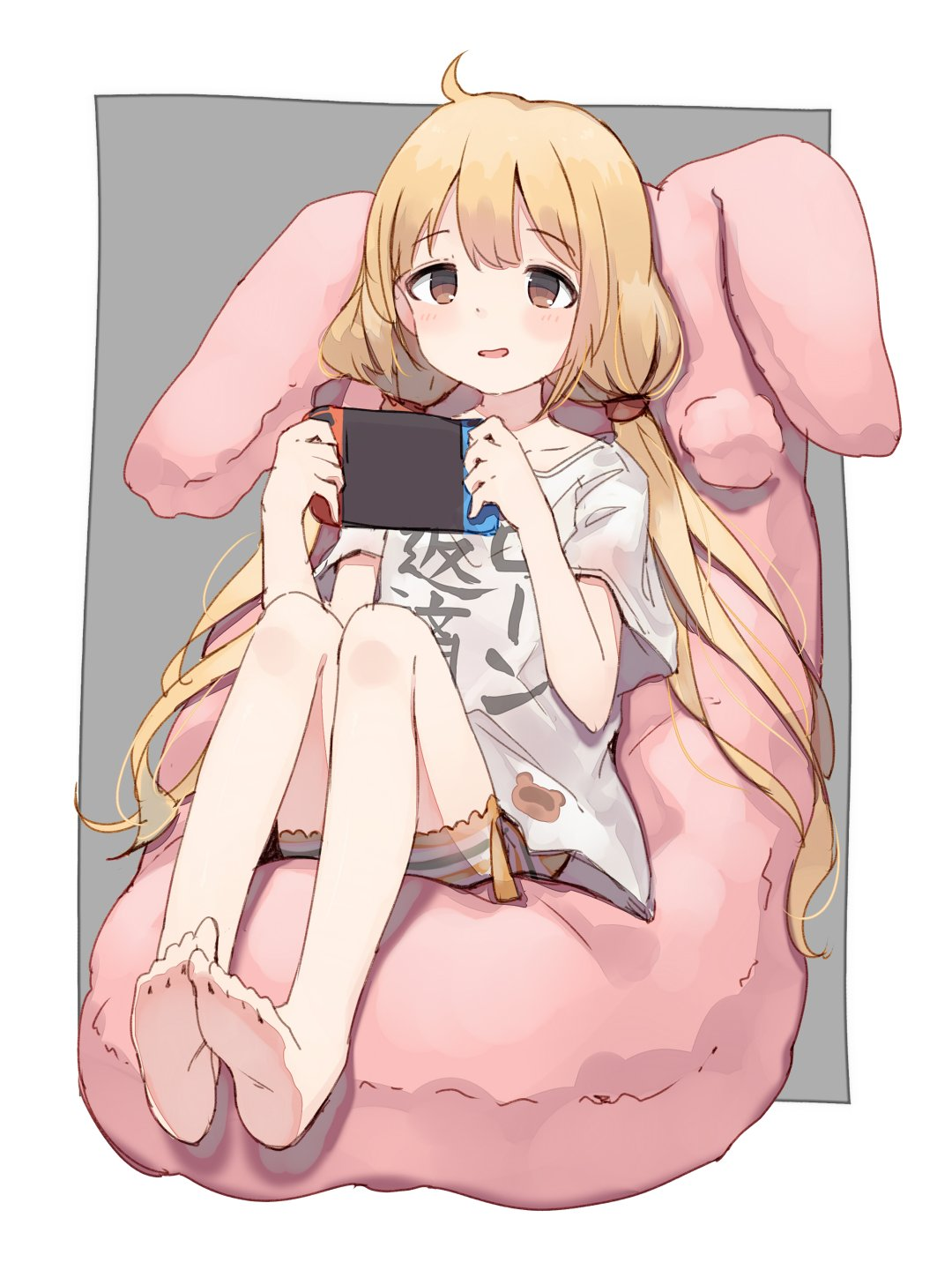 1girl bangs bare_legs barefoot bean_bag bike_shorts blonde_hair brown_eyes clothes_writing eyebrows_visible_through_hair feet full_body futaba_anzu grey_background handheld_game_console highres holding_handheld_game_console idolmaster idolmaster_cinderella_girls long_hair looking_at_viewer low_twintails nintendo_switch parted_lips shirt shone short_sleeves simple_background sitting soles solo striped striped_bike_shorts t-shirt twintails very_long_hair white_shirt