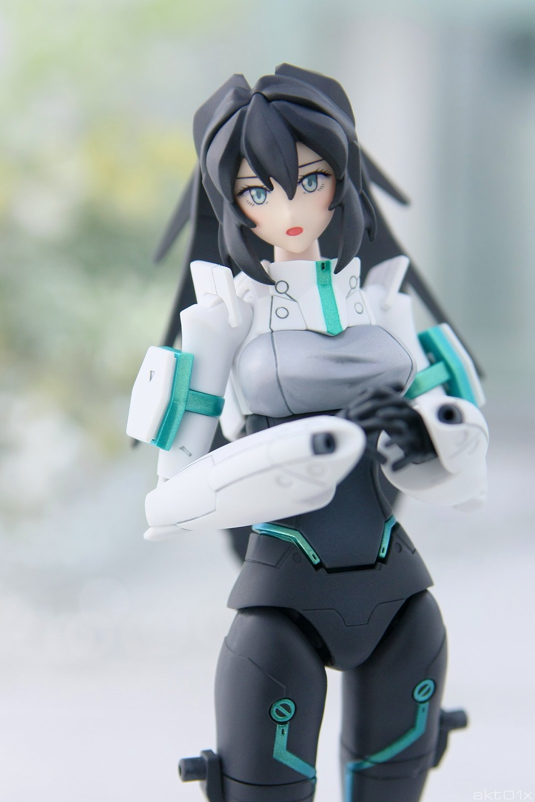 1girl akt01x black_hair grey_eyes gundam gundam_build_divers gundam_build_divers_re:rise gunpla hands_together highres looking_at_viewer may_(gundam_build_divers_re:rise) model_kit open_mouth photo solo