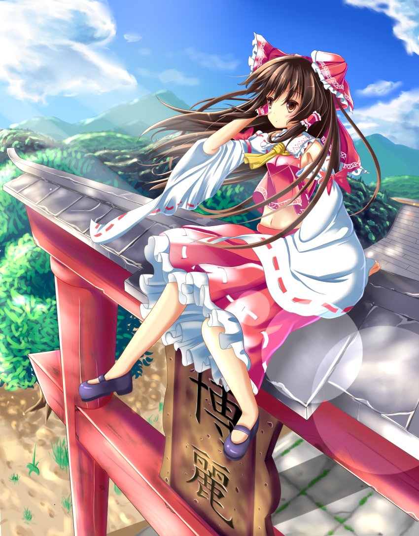 1girl :o blue_sky blush bow brown_hair clouds detached_sleeves frilled_skirt frills hair_bow hair_tubes hakurei_reimu highres leg_lift lens_flare long_hair looking_to_the_side mary_janes midriff mountain navel outdoors red_eyes shoes sitting_on_torii skirt skirt_set sky solo torii touhou unory wind