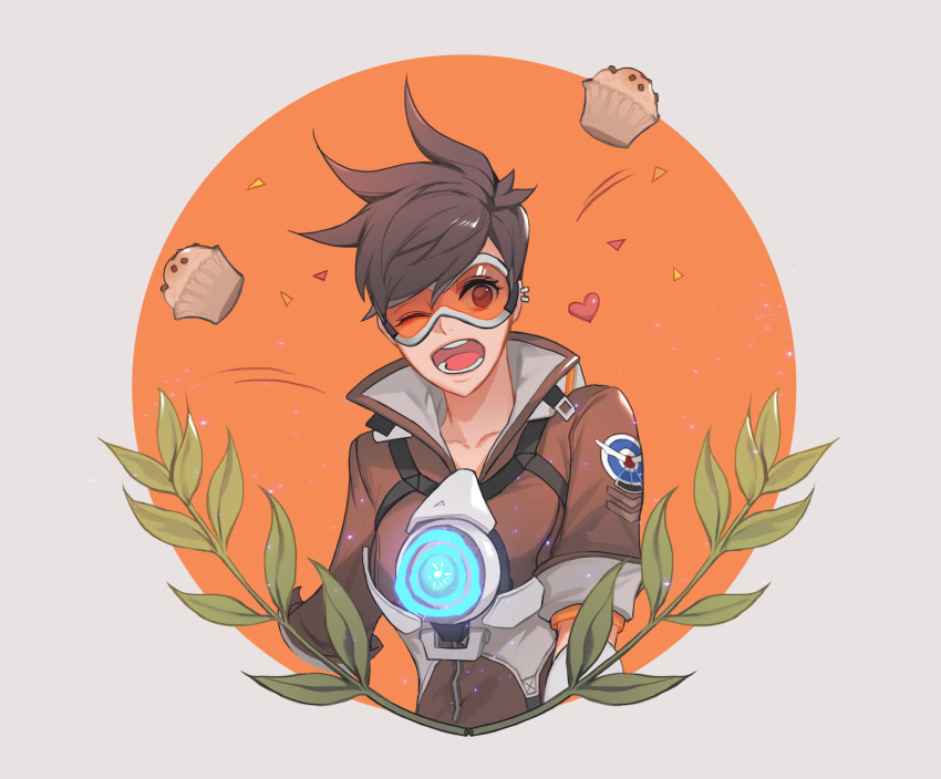 1girl ;d bangs bodysuit bomber_jacket brown_eyes brown_hair brown_jacket collarbone cupcake ear_piercing food goggles harness heart highres jacket leaf military_rank_insignia neosnim one_eye_closed open_mouth overwatch piercing plant short_hair sleeves_rolled_up smile solo spiky_hair spoken_heart strap teeth tracer_(overwatch) upper_body vambraces