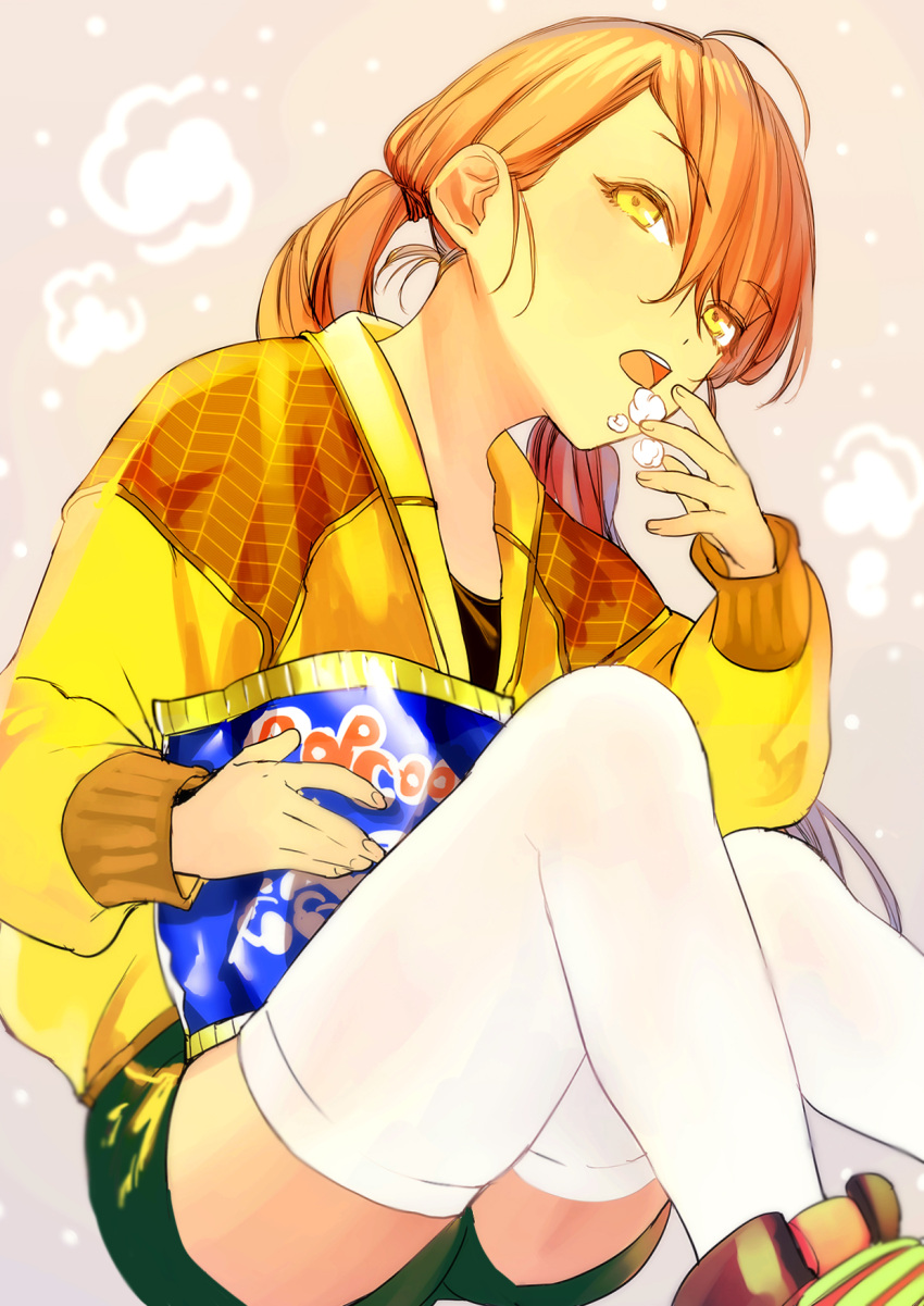 1girl ahoge bangs bent_knees eating eyebrows_visible_through_hair food green_shorts highres holding jacket long_hair looking_away multicolored_hair open_mouth orange_eyes orange_hair original orimotosiki ponytail popcorn shorts sitting thigh-highs two-tone_hair white_legwear yellow_jacket