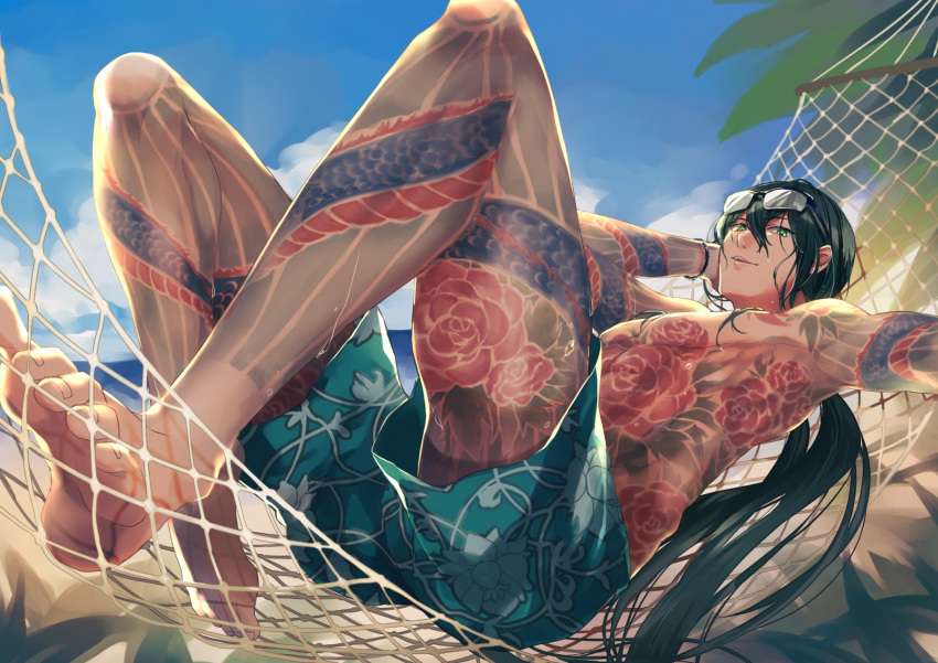 1boy barefoot beach black_hair blue_sky eyewear_on_head fate/grand_order fate_(series) full_body_tattoo glasses green_eyes hammock hand_behind_head highres looking_at_viewer male_focus male_swimwear parted_lips self_shot shoreline sky solo soso_(sosoming) swim_trunks swimwear tattoo yan_qing_(fate/grand_order)