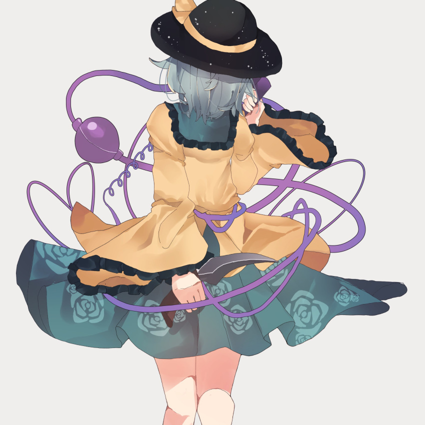 1girl back black_headwear collared_shirt commentary_request corded_phone floral_print frilled_sleeves frills from_behind green_skirt grey_background hat highres holding holding_knife holding_phone knife knife_behind_back komeiji_koishi long_sleeves phone ratako ribbon shirt short_hair silver_hair simple_background skirt solo standing string third_eye touhou wavy_hair wide_sleeves yellow_ribbon yellow_shirt
