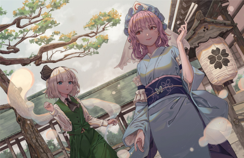 2girls :o arm_garter ascot bangs black_hairband black_neckwear black_ribbon blue_eyes blue_headwear blue_kimono blue_sash building clenched_hand clouds cloudy_sky cowboy_shot dutch_angle floral_print green_skirt green_vest hair_ribbon hairband hand_up hat hitodama japanese_clothes kimono konpaku_youmu konpaku_youmu_(ghost) lantern long_sleeves looking_at_another maachi_(fsam4547) mob_cap multiple_girls obi outdoors paper_lantern parted_lips pink_hair red_eyes ribbon saigyouji_yuyuko sash shirt short_hair silver_hair skirt skirt_set sky smile standing touhou tree triangular_headpiece veil vest white_shirt wide_sleeves