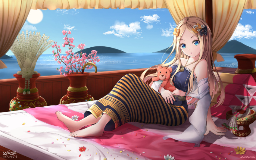 1girl abigail_williams_(fate/grand_order) bandeau bangs bare_shoulders barefoot bed black_bow blonde_hair blue_eyes blush bow breasts fate/grand_order fate_(series) flower_pot forehead hair_bow highres holding holding_stuffed_animal jewelry long_hair looking_at_viewer necklace ocean on_bed open_mouth orange_bow orange_skirt parted_bangs polka_dot polka_dot_bow skirt small_breasts solo striped striped_skirt stuffed_animal stuffed_toy tank_ryousaku teddy_bear