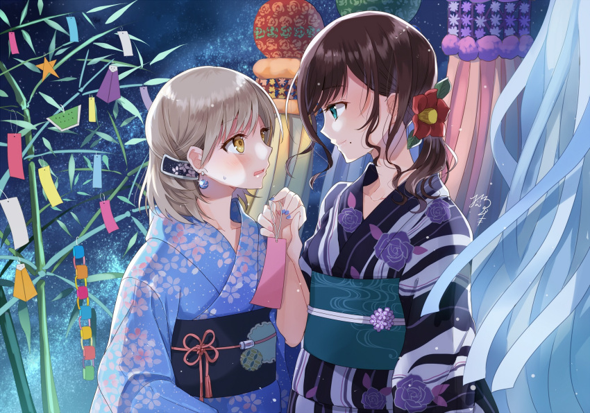 2girls bamboo black_hair blue_eyes blue_kimono blue_nails camellia commentary_request earrings eye_contact floral_print flower flower_knot hair_flower hair_ornament highres holding_hands japanese_clothes jewelry kimono light_brown_hair looking_at_another mole mole_under_mouth multiple_girls nail_polish nekozuki_yuki night obi original outdoors paper_chain ponytail red_flower sash sidelocks signature smile streamers tanabata tanzaku yellow_eyes yukata yuri