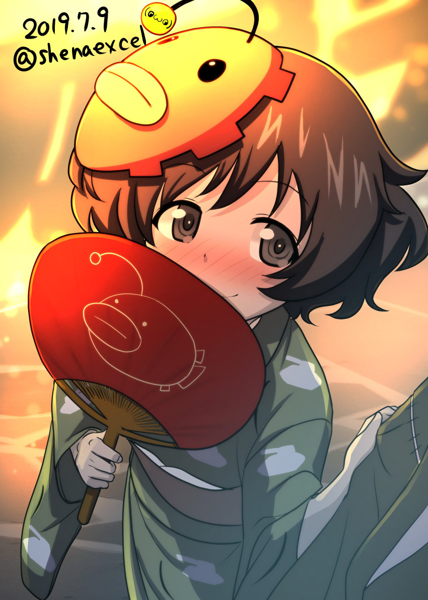1girl absurdres akiyama_yukari anglerfish arm_grab artist_logo bangs blurry blurry_background blush brown_eyes brown_hair closed_mouth commentary covering_mouth dated depth_of_field emblem excel_(shena) eyebrows_visible_through_hair fan girls_und_panzer green_kimono highres holding holding_fan japanese_clothes kimono long_sleeves looking_at_viewer mask mask_on_head messy_hair paper_fan pink_headwear pov print_kimono short_hair smile solo standing tank_print twitter_username