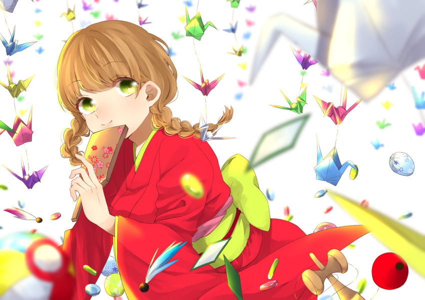 1girl blurry_foreground braid brown_hair furi08283370 green_eyes highres iroha_karuta japanese_clothes kendama kimono looking_at_viewer medium_hair obi origami original paper_crane red_kimono sash simple_background smile solo twin_braids twintails white_background wide_sleeves