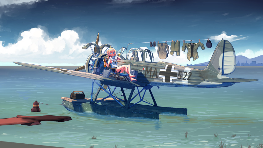 1girl aircraft airplane balkenkreuz barefoot beer_bottle black_shorts blonde_hair blue_eyes bottle bucket check_commentary clothes_pin clothes_removed clouds commentary commentary_request crossed_ankles day deck_chair drying drying_clothes erica_(naze1940) hat hat_removed headwear_removed highres holding holding_bottle horizon hot laundry looking_at_viewer low_ponytail medium_hair military military_uniform ocean original outdoors ponytail radio seaplane short_shorts shorts sitting sky sleeveless solo sunlight tank_top toolbox towel uniform vehicle_request water weapon wide_shot world_war_ii