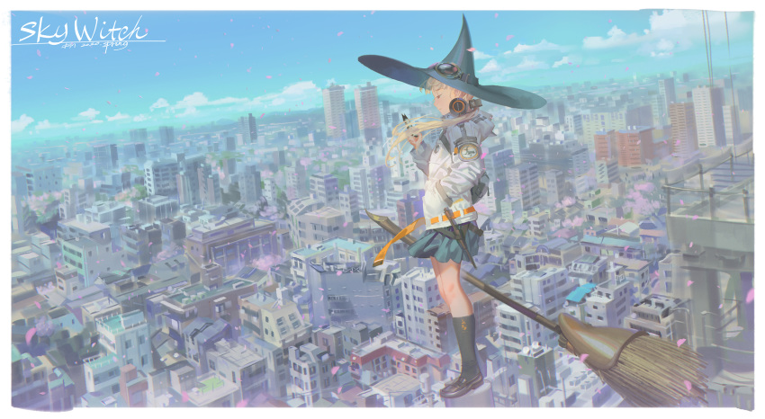 1girl alphonse_(white_datura) blonde_hair blue_sky broom brown_eyes cellphone cherry_blossoms city day hand_in_pocket hat headphones headphones_around_neck highres hood hood_down hooded_jacket jacket long_hair original outdoors petals phone profile sky smartphone solo standing wind witch_hat