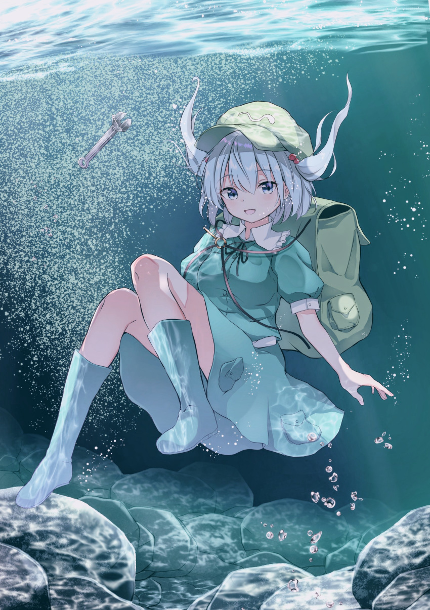 1girl absurdres air_bubble backpack bag blue_eyes blue_footwear blue_hair blue_shirt blue_skirt boots breasts bubble caustics commentary_request eyebrows_visible_through_hair flat_cap freediving green_headwear hair_between_eyes hair_bobbles hair_ornament hat highres iyo_(ya_na_kanji) kawashiro_nitori key looking_at_viewer medium_breasts parted_lips puffy_short_sleeves puffy_sleeves rock rubber_boots shirt short_hair short_sleeves skirt solo touhou two_side_up underwater wrench