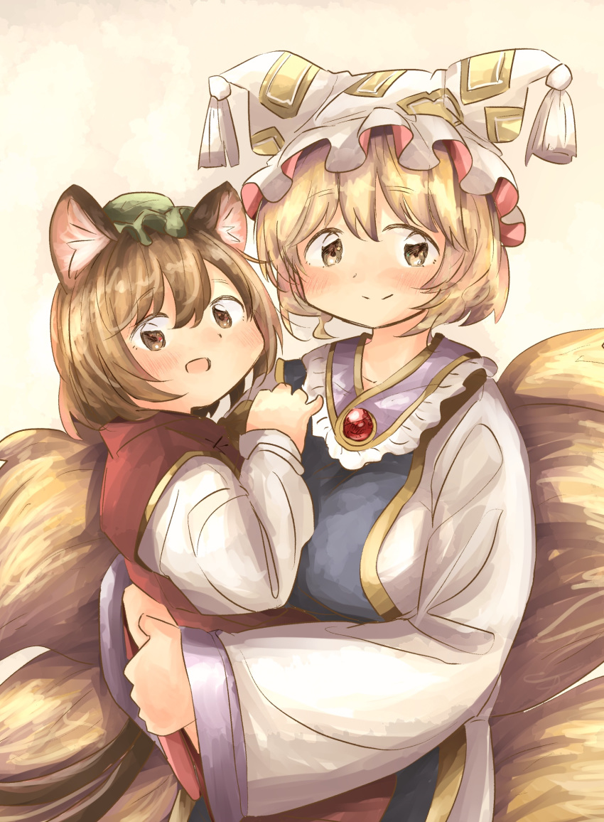 2girls animal_ears arms_up bangs blonde_hair blush brooch brown_eyes brown_hair cat_ears chen commentary dress eyebrows_visible_through_hair fox_tail gradient gradient_background green_headwear hat highres holding_person jewelry long_sleeves looking_at_viewer mob_cap multiple_girls multiple_tails ofuda_on_clothes open_mouth pillow_hat pink_background red_vest shirt short_hair shuu_(sirokumasabu) smile standing symbol_commentary tabard tail tassel touhou upper_body vest white_dress white_shirt yakumo_ran yellow_eyes