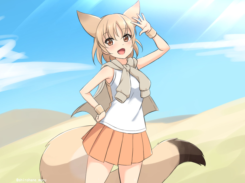 1girl :d absurdres animal_ears arm_up bare_arms blonde_hair blue_sky brown_eyes clouds cowboy_shot day desert extra_ears fox_ears fox_girl fox_tail hand_on_hip highres jacket jacket_on_shoulders kemono_friends large_tail looking_at_viewer open_mouth orange_skirt outdoors pale_fox_(kemono_friends) pleated_skirt shiraha_maru shirt short_hair skirt sky sleeveless sleeveless_shirt smile solo sunlight tail tied_jacket twitter_username wristband