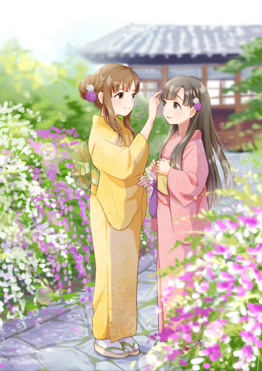 2girls architecture artist_name bangs black_hair blunt_bangs blurry blurry_background braid brown_eyes brown_hair day east_asian_architecture eye_contact flower hair_flower hair_ornament highres idolmaster idolmaster_cinderella_girls japanese_clothes kimono kobayakawa_sae looking_at_another mitsuyahachiko mizumoto_yukari multiple_girls outdoors pink_kimono sandals smile white_legwear yellow_kimono yuri