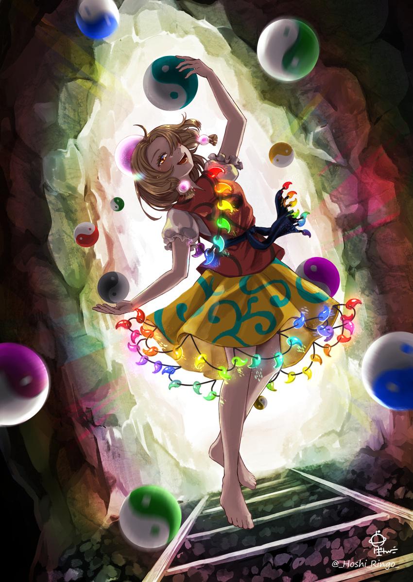barefoot blonde_hair blouse brown_eyes brown_hair crown earrings headpiece highres hoshiringo0902 jewelry magatama medium_hair medium_skirt multicolored multicolored_clothes multicolored_hair orb patterned_clothing puffy_short_sleeves puffy_sleeves red_blouse short_sleeves skirt tamatsukuri_misumaru tiara touhou two-tone_hair yellow_skirt yin_yang yin_yang_orb