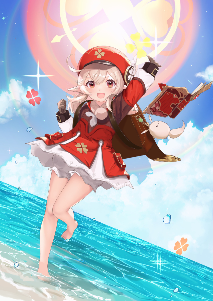 1girl :d ahoge arin_(1010_ssu) arm_up backpack bag bag_charm bangs barefoot beach bloomers blue_sky book brown_gloves brown_scarf cabbie_hat charm_(object) clouds cloudy_sky clover_print coat commentary_request dodoco_(genshin_impact) eyebrows_visible_through_hair floating floating_object genshin_impact gloves hair_between_eyes hat hat_feather hat_ornament highres horizon in_water klee_(genshin_impact) long_hair long_sleeves looking_at_viewer low_twintails ocean open_mouth pocket pointy_ears randoseru red_coat red_headwear scarf sidelocks sky smile solo standing standing_on_one_leg toes twintails underwear