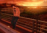 1boy brown_hair clouds fence hands_in_pockets headphones highres jacket kurono-kuro leaning_back original short_hair sky solo sunset