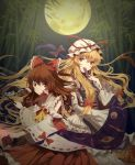 2girls bamboo bamboo_forest blonde_hair bow brown_eyes brown_hair covering_mouth fan folding_fan forest full_moon hair_bow hair_ribbon hakurei_reimu hat highres imperishable_night long_hair moon multiple_girls nae_(artist) nature night ribbon touhou violet_eyes yakumo_yukari