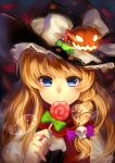 1girl blonde_hair braid candy hair_ornament halloween hat highres jack-o'-lantern kirisame_marisa kyuri_(405966795) lollipop long_hair skull_hair_ornament solo star touhou witch_hat