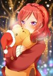 1girl bisuke_(bisco) blurry blush braid christmas_lights depth_of_field hat long_sleeves looking_at_viewer love_live!_school_idol_project nishikino_maki object_hug redhead santa_hat short_hair sleeves_past_wrists smile solo stuffed_animal stuffed_toy teddy_bear tree tsurime violet_eyes