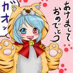 akeome animal_costume blush commentary_request cosplay heterochromia kigurumi new_year tatara_kogasa tiger_costume tiger_print tongue tongue_out touhou yuzuna99