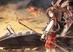 1girl airplane bow_(weapon) boyogo brown_eyes brown_hair clouds fighter_jet fingerless_gloves gloves hachimaki hair_ribbon headband high_ponytail highres japanese_clothes jet kantai_collection long_hair military muneate open_mouth ponytail ribbon single_glove sky smile solo weapon zuihou_(kantai_collection)