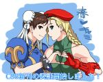 2girls beret blonde_hair blue_eyes bracelet braid brown_eyes brown_hair bun_cover cammy_white china_dress chinese_clothes chun-li comiket_88 double_bun forehead-to-forehead hat heart heart_hands heart_hands_duo jewelry leotard multiple_girls murderhouse puffy_sleeves spiked_bracelet spikes twin_braids