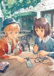 2girls absurdres blonde_hair blue_eyes brown_eyes brown_hair cable case cellphone chair chin_rest coaster collarbone cup drink drinking_straw earphones earphones glass hat highres holding hood hooded_jacket jacket jewelry katou_akatsuki multiple_girls necklace open_clothes open_jacket original outdoors parted_lips phone pointing saucer shirt short_hair smartphone smile star striped table teacup tree unzipped white_shirt zipper