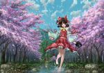 1girl absurdres ascot barefoot black_hair blue_sky cherry_blossoms clouds detached_sleeves full_body hair_ribbon hair_tubes hakurei_reimu highres japanese_clothes lake landscape long_sleeves looking_at_viewer midriff miko nature open_mouth petals ribbon ribbon-trimmed_sleeves ribbon_trim scenery shirt short_hair skirt skirt_set sky smile solo torii touhou tree ultra-taf water wide_sleeves
