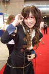 1girl brown_hair cosplay curly_hair glasses long_hair photo red-framed_glasses smile solo_focus tiara