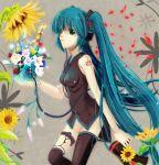 flower green_eyes hatsune_miku kazumasa long_hair megaphone sunflower thigh-highs thighhighs twintails very_long_hair vocaloid
