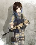 1girl black_gloves brown_eyes brown_hair camouflage camouflage_jacket camouflage_pants closed_mouth collarbone cowboy_shot fn_scar gloves gun highres holding holding_gun holding_weapon holster kevlar_vest knee_pads long_sleeves looking_at_viewer military military_uniform nuqura original pants shadow short_hair sleeves_rolled_up solo standing thigh_holster uniform wall weapon woodland_pattern