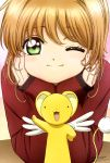 1girl absurdres brown_hair card_captor_sakura green_eyes hamada_kunihiko hands_on_own_cheeks hands_on_own_face highres kero kinomoto_sakura looking_at_viewer one_eye_closed short_hair smile tail wings