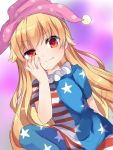 1girl american_flag arm_behind_back bangs blonde_hair closed_mouth clownpiece cowboy_shot eyebrows_visible_through_hair frilled_shirt_collar frills hand_on_own_cheek hand_up hat highres jester_cap karasusou_nano long_sleeves looking_at_viewer multicolored multicolored_eyes polka_dot short_sleeves solo touhou