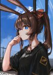 1girl amiya_(arknights) animal_ears arknights black_shirt blue_eyes blue_sky brown_hair close-up clouds expressionless eyebrows_visible_through_hair from_side hand_on_own_cheek hand_on_own_face highres long_hair looking_at_viewer looking_to_the_side loose_clothes loose_shirt multicolored multicolored_eyes omuretu_(butterroru) ponytail rabbit_ears red_eyes red_ribbon ribbon shirt sky solo t-shirt utility_pole