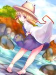 1girl barefoot blonde_hair brown_eyes clouds feet from_behind hat highres leaning_forward legs looking_back midriff moriya_suwako outdoors purple_skirt purple_vest ribbon river rock shirt short_hair skirt sky sleeves_past_wrists soles solo tiptoes totolarc touhou tree vest water white_shirt