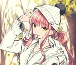 1girl adjusting_clothes adjusting_hat alternate_costume beanie braid casual collarbone fate/grand_order fate_(series) hat jewelry leaf looking_at_viewer medb_(fate/grand_order) mouth_hold necklace pink_hair pom_pom_(clothes) ponytail shimo_(s_kaminaka) solo tree yellow_eyes