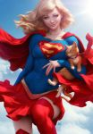 1girl animal blonde_hair blue_eyes blue_sky boots cape cat clouds covered_navel dc_comics emblem highres looking_at_viewer medium_hair midair realistic red_cape red_legwear red_skirt signature skirt sky smile stanley_lau sunlight supergirl superhero superman_(series) thigh-highs thigh_boots zettai_ryouiki