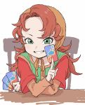1girl absurdres bangs blush brown_hair card chair commentary_request dragon_quest dragon_quest_vii green_eyes green_tunic grin hand_up head_scarf highres holding holding_card long_hair long_sleeves looking_at_viewer maribel_(dq7) messy_hair short_over_long_sleeves short_sleeves sitting sleeveless slime_(dragon_quest) smile solo tsurime tunic upper_body very_long_hair white_background wide_sleeves yamamoto_souichirou