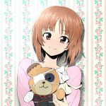 1girl bandage bangs boko_(girls_und_panzer) brown_eyes brown_hair cast casual closed_mouth eyepatch floral_background girls_und_panzer holding holding_stuffed_animal kuromorimine_military_uniform long_sleeves looking_at_viewer nakahira_guy nishizumi_miho pink_shirt portrait shirt short_hair smile solo stuffed_animal stuffed_toy teddy_bear wallpaper_(object)