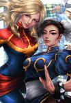 2girls blonde_hair blue_eyes bracelet brown_hair bun_cover capcom captain_marvel carol_danvers chinese_clothes chun-li copyright_name double_bun earrings jewelry logo looking_at_viewer marvel marvel_vs._capcom marvel_vs._capcom_infinite multiple_girls sash spiderwee spiked_bracelet spikes street_fighter superhero upper_body