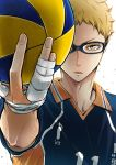 1boy ball bandage bandaged_hands blonde_hair blue-framed_eyewear clothes_writing colored_eyelashes commentary_request fingernails foreshortening glasses haikyuu!! hand_up holding holding_ball looking_at_viewer male_focus serious simple_background sportswear sweat tsukishima_kei upper_body volleyball volleyball_uniform white_background wing_collar yellow_eyes
