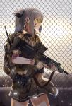 1girl assault_rifle backpack bag bag_charm black_skirt brown_gloves casino_(casinoep) chain-link_fence charm_(object) closed_mouth cowboy_shot fence fingerless_gloves from_behind gloves goggles grey_hair gun headset highres holding holding_gun holding_weapon l85 lens_flare load_bearing_vest long_hair military original outdoors pleated_skirt ponytail profile rifle scope short_sleeves sidelocks skirt solo tattoo trigger_discipline weapon yellow_eyes