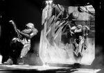 2girls against_wall arm_cannon doorway fusion_suit glowing glowing_eyes greyscale hallway helmet hiding metroid metroid_fusion monochrome multiple_girls power_armor sa-x samus_aran shadow squatting tristan_jones water weapon wire