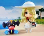 1girl bag beach blonde_hair blue_sky braid chibi clouds commentary_request cosplay dress figure full_body garchomp hair_over_one_eye hat lillie_(pokemon) lillie_(pokemon)_(cosplay) long_hair outdoors photo pokemoa pokemon pokemon_(game) pokemon_sm shirona_(pokemon) sky smile toy twin_braids