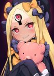 1girl abigail_williams_(fate/grand_order) bangs black_bow black_dress black_hat blonde_hair blush bow dress fate/grand_order fate_(series) grin hair_bow hands_in_sleeves hat head_tilt lo_xueming long_sleeves looking_at_viewer object_hug orange_bow parted_bangs polka_dot polka_dot_bow red_eyes sharp_teeth smile solo stuffed_animal stuffed_toy teddy_bear teeth third_eye v-shaped_eyebrows