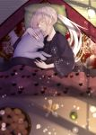 1girl artoria_pendragon_(all) blonde_hair carpet closed_eyes commentary_request dog fate/grand_order fate_(series) food from_above fruit fur_trim highres light_particles lip-mil long_hair orange orange_slice parted_lips pillow ponytail saber_alter sleeping yellow_eyes