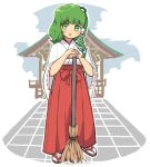 1girl :d blush broom commentary_request frog_hair_ornament full_body green_eyes green_hair hair_ornament hakama highres japanese_clothes kochiya_sanae long_sleeves looking_at_viewer miko open_mouth outdoors red_skirt sandals sasa_kichi shrine skirt smile snake_hair_ornament solo standing tabi touhou white_legwear wide_sleeves