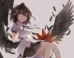 1girl black_skirt black_wings breasts brown_hair fan feathered_wings feathers finger_to_chin grey_background hair_between_eyes hat highres holding holding_fan leaf_fan looking_at_viewer medium_breasts parted_lips petticoat pointy_ears pom_pom_(clothes) puffy_short_sleeves puffy_sleeves shameimaru_aya shirt short_hair short_sleeves simple_background sitting skirt solo tassel thkani tokin_hat touhou white_shirt wings wrist_cuffs
